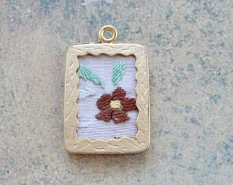 Framed embroidered linen pendant