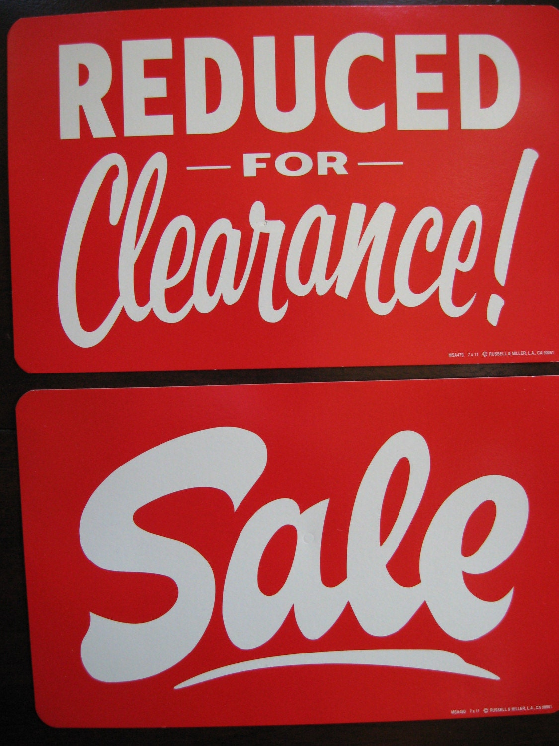 SALE REDUCED FOR CLEARANCE SALE signs