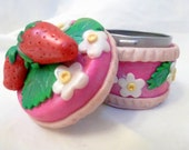 Luscious strawberries with white flowers on pink polymer clay metal tin