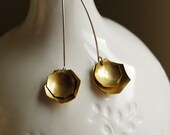 brass and sterling silver eggshell moveable earrings. Handmade in Chicago.