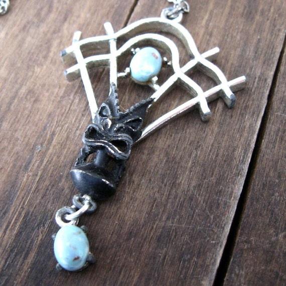 Vintage Tiki Necklace on a Silver Trellis