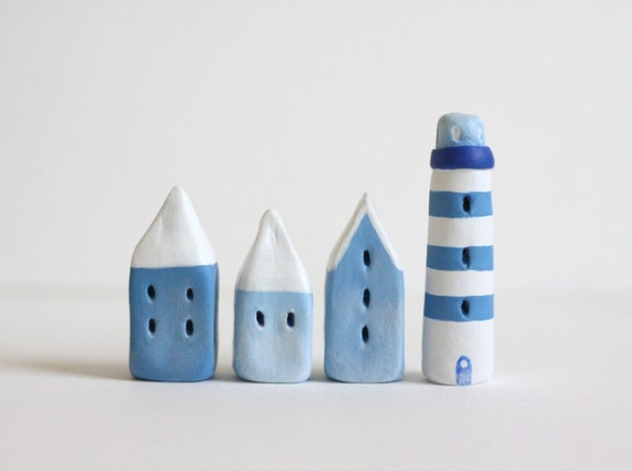 Reserved for Vanessa - Little village with three blue houses and a lighthouse