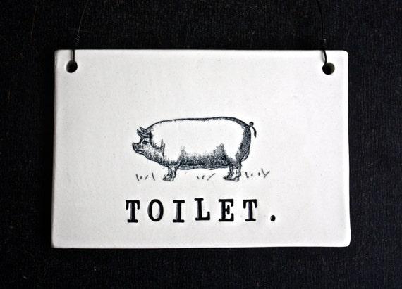 toilet plaque pig. Black Bedroom Furniture Sets. Home Design Ideas