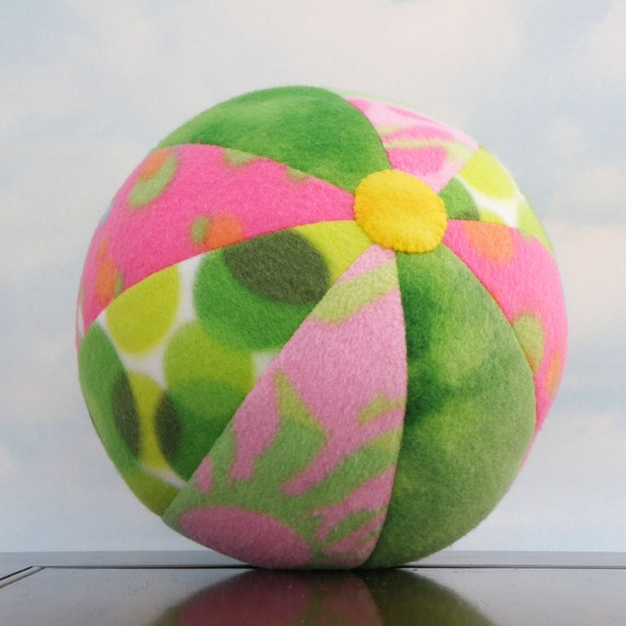 Get Unplugged with a Yellow Spot Ball - soft fleece ball in pink and green