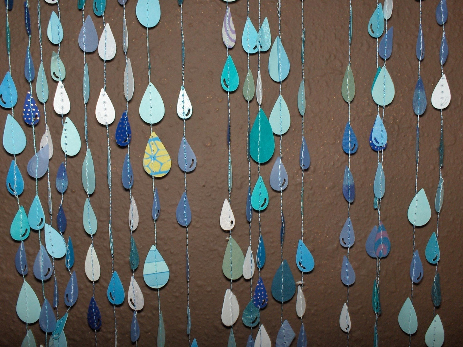 Sewn paper raindrop decorations for Decoration paper