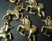 unicorn metal charms  gold coloured x 10