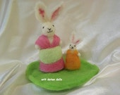 Needle felted wool mother and child bunnies standing on a green grass- needle felt wool sculpture made of natural materials