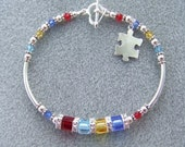 Autism,Aspergers,ASD,PDD Awareness Bracelet with Swarovski Crystals and Sterling Silver