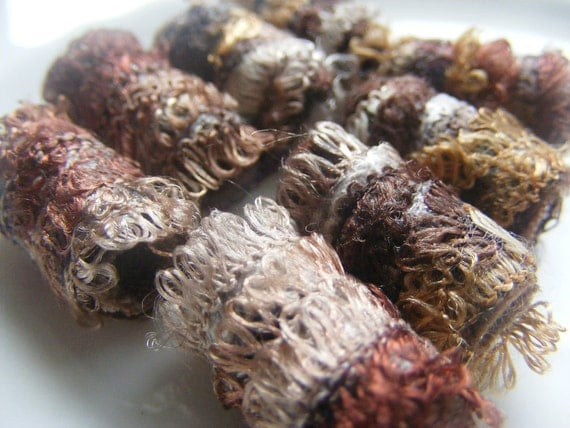 Imagine our surprise. Who knew there were this many shades of brown in the world. Fiber Bead, Dread bead, artisan jewelry bead, chunky bead