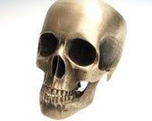 the full skull ring in bronze