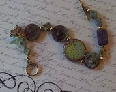 Butterfly bracelet --- Butterfly wing resin art focal --- Picasso beads --- Butterfly and crystal charm dangles
