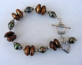 Brown green pearl bracelet lots of sterling silver toggle dangle look for sale code