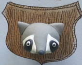 Tiny Trophy magnet Rocky Raccoon
