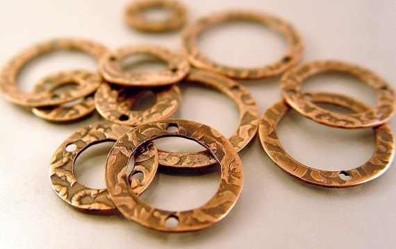 drilled copper patterned washers for jewelry making  set of ten  pieces