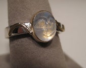 Carved Face Rainbow Moonstone ... Sterling and 14 kt Gold Ring... size 7