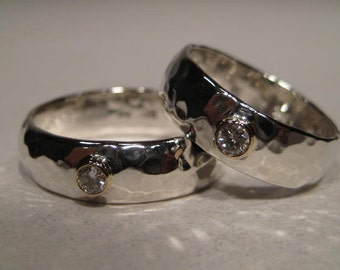 A Classic . Gently Domed. Hand Hammered Sterling Silver Band set. Diamond Set in 14 kt Gold..