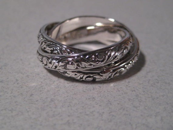 New Leaf ... Rolling  Ring ... Sterling Silver ... CooL ...