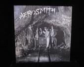 AEROSMITH--NIGHT IN THE RUTS--VINYL RECORD FC 36050