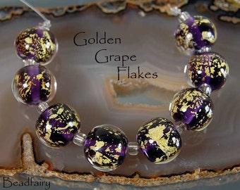 Golden Grape Flakes,  8 spheres, handmade glass beads,  dark purple with gold by Beadfairy Lampwork, SRA