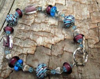 Blue and purple twisted furnace glass, sterling silver and lampwork beaded bracelet