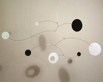 Black and White Neptune mobile art sculpture by Julie Frith