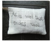 Lavender sachet in linen with embroidered text 'All is well that endes well'