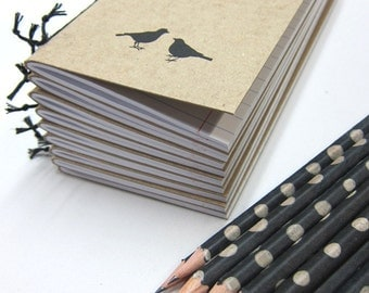 Notebook  with Two Birds and a Pencil
