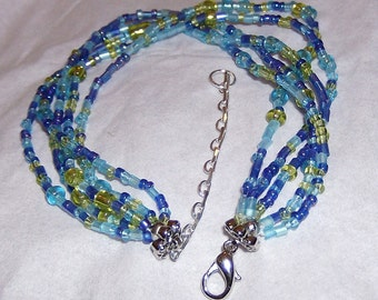 blue with a few gold beads silver floweet bead cap silver lobster claw clasp