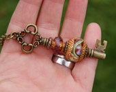 Add A Bead brass plated changeable Key Pendant with K O Lampwork European Charm Bead
