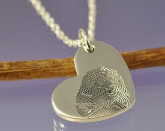 Fingerprint heart pendant. Your finger print hand engraved onto a sterling silver pendant.