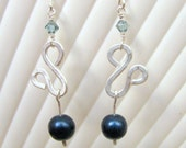 handwrapped wire work earrings - blue druk bead