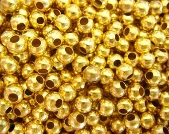 200 gold covered round metal spacer beads 4mm