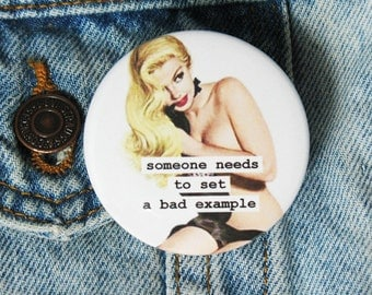 funny pinback button.  pinup girl 2.25 inch. someone needs to set a bad example