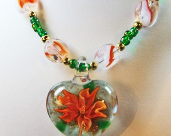 Valentines Orange Flower Green Leaf in a Glass Heart Pendant on a Orange and Green Beaded Necklace
