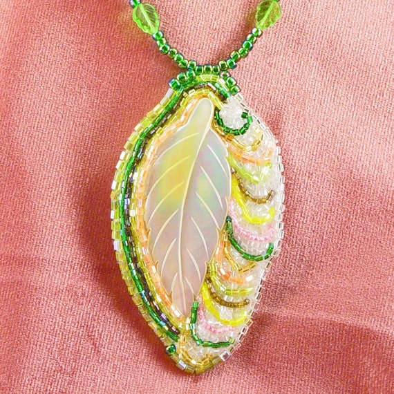 Handcrafted bead embroidered carved shell leaf necklace green