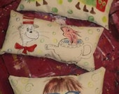 Set of three children's book character pillows