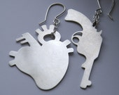 Love Me or Leave Me - sterling silver gun and anatomical heart earrings