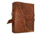Leonardo da Vinci quote . Vitruvian Man . handbound leather journal . distressed brown (320 pgs)