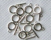 Ten Tiny Silver-toned Toggle Clasps...price includes shipping