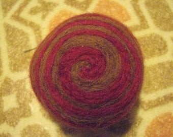 One multi-colored felted pin-cushion, Red and Brown