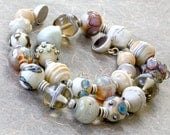 Lampworks glass beads in jewel-like necklace