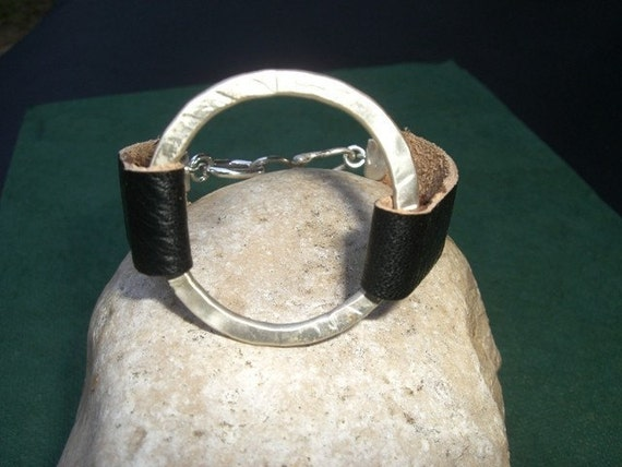 silver circle and leather bracelet