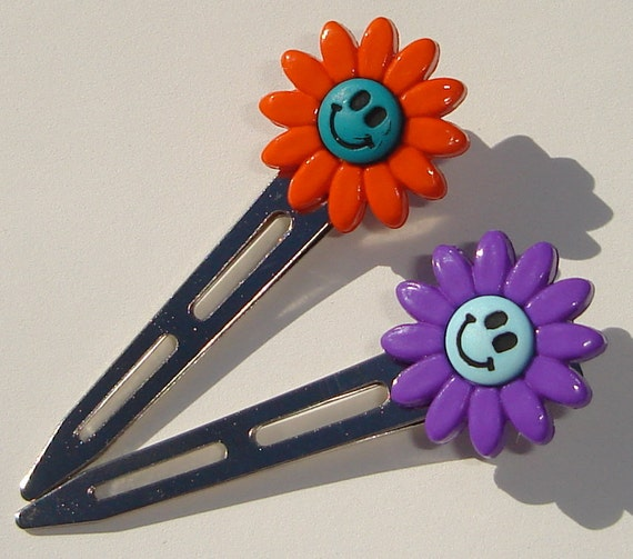 set of 2 hair clips with colorful happy face flower button embellishments