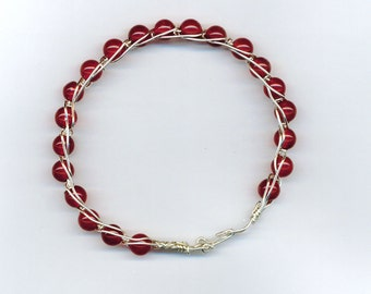 Carnelian and Silver colored wire braided Bracelet