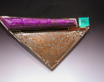Mokume Gane Brooch with Emerald and Sugelite in 18 karat Gold PACIFIC STORM WATCH
