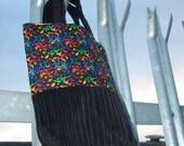 new rave paint splatter and black cord bag