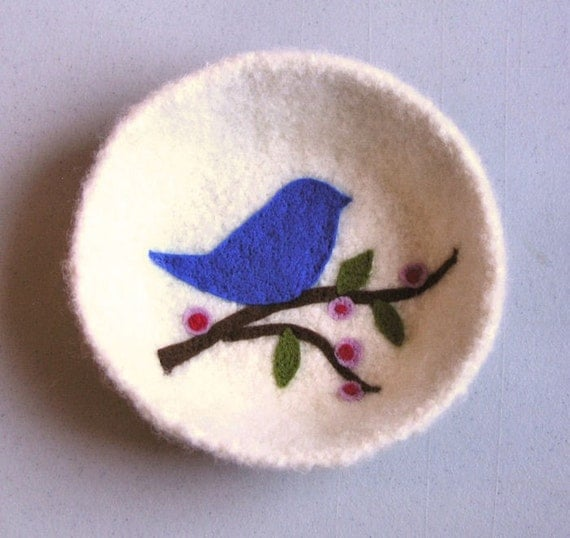Felted bowl with a little bird and branches in the bottom