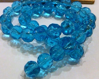Closeout - 14 Inch Strand of Glass Turquoise Round Faceted Beads