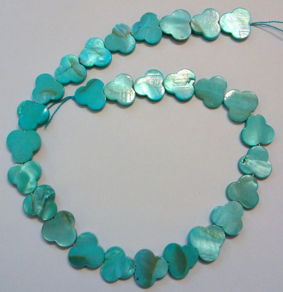 1 15 inch strand painted aqua/turquoise shell beads