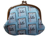 Coin purse with friendly notebook paper on blue